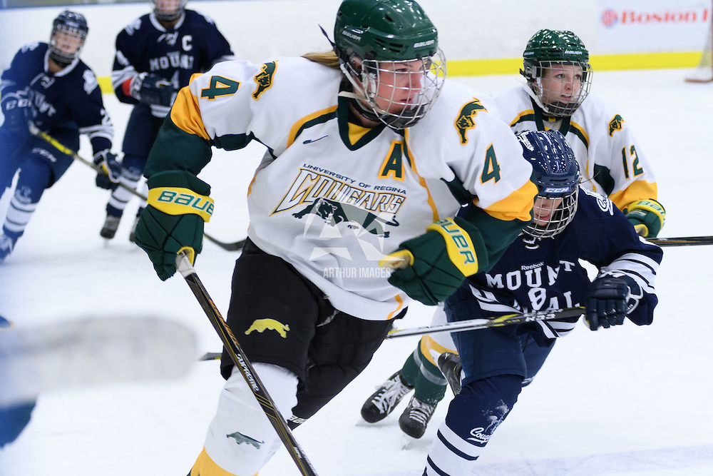 5th year defender Krista Metz (4) of the Regina Cougars in action during the Women's Hockey Homeopener on October 7 at Co-operators arena. Credit: Arthur Ward/Arthur Images