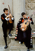 Musicians playing classical guitar at a cultural event in Portugal