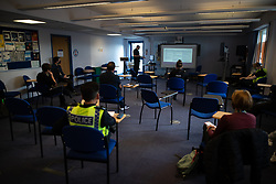 © Licensed to London News Pictures . 11/09/2020. Bolton , UK . A joint briefing takes place at Bolton Police Station ahead of the patrol . Police officers from Greater Manchester Police and Environmental Health Officers from Bolton Council respond to concerns of breaches of Coronavirus regulations , as stricter lockdown measures and a curfew on hospitality businesses are imposed in the borough to limit the spread of Covid-19 . Photo credit : Joel Goodman/LNP