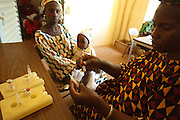 Vaccinator Koumba N'Diaye prepares to vaccinate a child at the Kita reference health center in the town of Kita, Mali on Monday August 30, 2010..