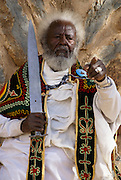 Portrait of an Ethiopian senior man brandishing a sword during Timket, the Ethiopian Orthodox celebration of Epiphany, the revelation of God in human form in the person of Jesus Christ, Axum, Ethiopia