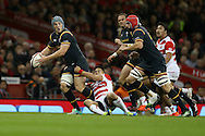 Jonathan Davies of Wales looks to get a pass away with Cory Hill of Wales (r) in support. Under Armour 2016 series international rugby, Wales v Japan at the Principality Stadium in Cardiff , South Wales on Saturday 19th November 2016. pic by Andrew Orchard, Andrew Orchard sports photography