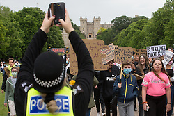 Windsor, UK. 4 June, 2020. A Thames Valley Police officer takes a photograph of hundreds of young people taking part in a peaceful protest march along the Long Walk in front of Windsor Castle in solidarity with the Black Lives Matter movement. The march was organised at short notice by Jessica Christie at the request of her daughter Yani, aged 12, following the death of George Floyd while in the custody of police officers in Minneapolis in the United States.