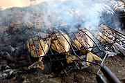 Freshly caught local fish being grilled on a barbeque at a restaurant on the small island of Gili Sudak, Lombok, Indonesea
