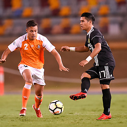 BRISBANE, AUSTRALIA - JANUARY 23: Junior Munoz of Ceres Negros passes the ball under pressure from Dane Ingham of the Roar during the AFC Champions League Second Preliminary Round match between Brisbane Roar and Ceres Negros FC on January 23, 2017 in Brisbane, Australia. (Photo by Patrick Kearney)