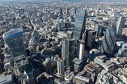 © Licensed to London News Pictures. 26/04/2016. London, UK. The Gherkin or 30 St Mary's Axe, Moorgate area. The city of London bathes in the Autumn sunshine. Photo credit: Martin Apps/LNP