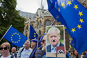 On the day that rebel Conservative Party rebels and opposition MPs attempt to pass a law designed to prevent a no-deal Brexit by the government of Prime Minister Boris Johnson, pro-EU Remainers protest with a picture of Johnson as Hitler outside Parliament, on 3rd September 2019, in Westminster, London, England.