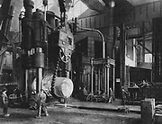 World War I 1914-1918: Krupp works, Essen, Ruhr, Germany, 1917. Using a hydraulic press to for a 100 ton block.  Industry, Armaments, Factory, Forge, Metal