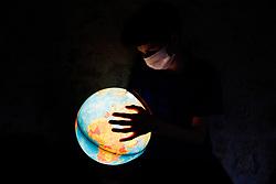 Symbolic images - Coronavirus with Child and Earth globe on may 2, 2020. Photo by Marie Hubert Psaila/ABACAPRESS.COM