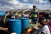 Volunteers with Water Warriors clean up after a day's work at Navajo Technical University in Crownpoint, New Mexico.