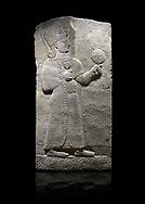 Hittite relief sculpted orthostat stone panel of Long Wall Basalt, Karkamıs, (Kargamıs), Carchemish (Karkemish), 900-700 B.C. Anatolian Civilizations Museum, Ankara, Turkey.<br /> <br /> Goddess Kubaba. Goddess is depicted from the profile. The part below the chest of the relief is broken. She holds a pomegranate in her hands on her chest. She carries a one-horned headdress on her head. Her braided hair hangs down to her shoulder. The text in the hieroglyphics is not understood. The lower part of the relief has been restored. <br /> <br /> On a black background. .<br />  <br /> If you prefer to buy from our ALAMY STOCK LIBRARY page at https://www.alamy.com/portfolio/paul-williams-funkystock/hittite-art-antiquities.html  - Type  Karkamıs in LOWER SEARCH WITHIN GALLERY box. Refine search by adding background colour, place, museum etc.<br /> <br /> Visit our HITTITE PHOTO COLLECTIONS for more photos to download or buy as wall art prints https://funkystock.photoshelter.com/gallery-collection/The-Hittites-Art-Artefacts-Antiquities-Historic-Sites-Pictures-Images-of/C0000NUBSMhSc3Oo