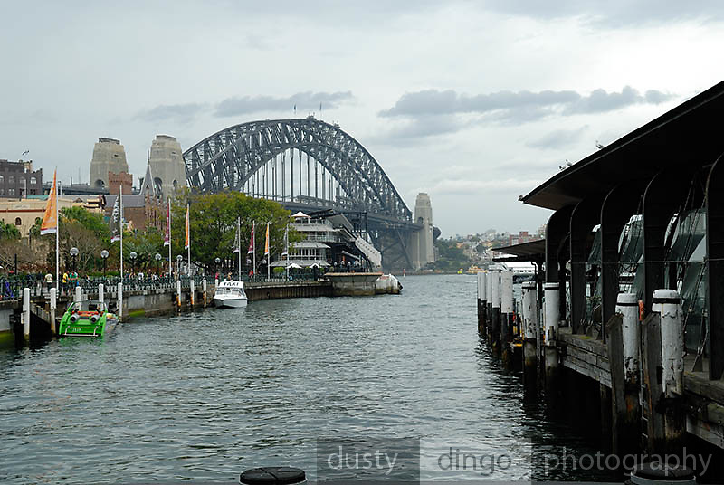 This is the first view of Sydney Harbour Bridge most visitors see--immediately after stepping from the Circular Quay Railway Station. Circular Quay, Sydney, Australia