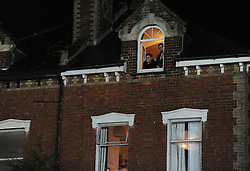 Exeter fans watch from there bedroom window for the liverpool team  arrival.  - Mandatory byline: Alex James/JMP - 08/01/2016 - FOOTBALL - St James Park - Exeter, England - Exeter City v Liverpool - FA Cup Third Round