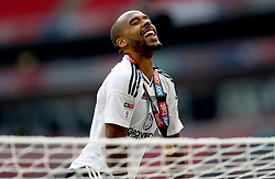 Fulham's Dennis Odoi climbs on top of a goal net as he celebrates promotion after the final whistle during the Sky Bet Championship Final at Wembley Stadium