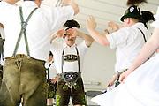 German folk dancers wearing traditional lederhosen costumes. Grand Old Day Festival. St Paul Minnesota MN USA