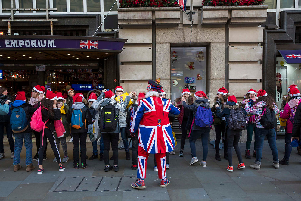 French students visiting Piccadilly Emporium in Santa hats, Piccadilly Circus, London, United Kingdom.