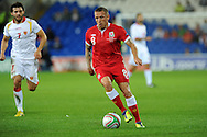 Craig Bellamy  of Wales makes a break.  Euro 2012 Qualifying match, Wales v Montenegro at the Cardiff City Stadium in Cardiff  on Friday 2nd Sept 2011. Pic By  Andrew Orchard, Andrew Orchard sports photography,