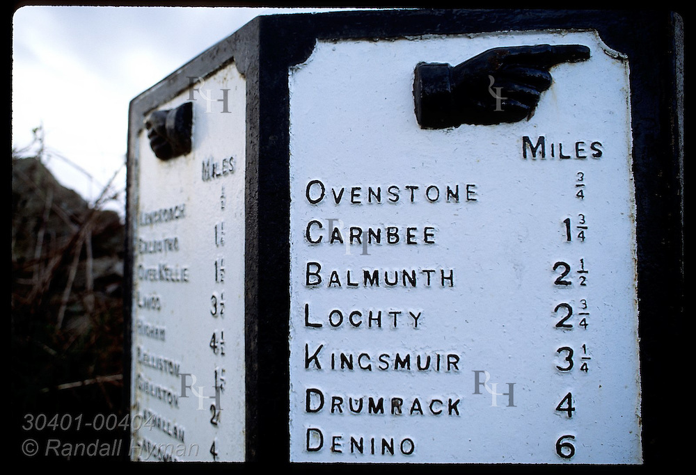 Old iron road sign gives distances to various towns in East Neuk of Fife. Scotland