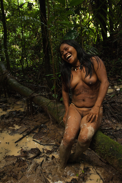 Huaorani woman, Awame Gomoke.<br /> Bameno Community. Yasuni National Park.<br /> Amazon rainforest, ECUADOR.  South America<br /> This Indian tribe were basically uncontacted until 1956 when missionaries from the Summer Institute of Linguistics made contact with them. However there are still some groups from the tribe that remain uncontacted.  They are known as the Tagaeri & Taromenane. Traditionally these Indians were very hostile and killed many people who tried to enter into their territory. Their territory is in the Yasuni National Park which is now also being exploited for oil.