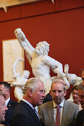 The Prince of Wales (left) talks with guests as he attends a dinner at Crawford Art Gallery as part of his tour of the Republic of Ireland with the Duchess of Cornwall. PRESS ASSOCIATION Photo. PRESS ASSOCIATION Photo. Picture date: Thursday June 14, 2018. See PA story ROYAL Charles. Photo credit should read: Brian Lawless/PA Wire