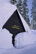 Deep winter snow covers a wooden building in Lake Tahoe, California