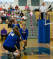 Winnisquam's Talia DeBlasie bumps the ball during NHIAA Division III volleyball with Moultonboro Monday evening.  (Karen Bobotas/for the Laconia Daily Sun)
