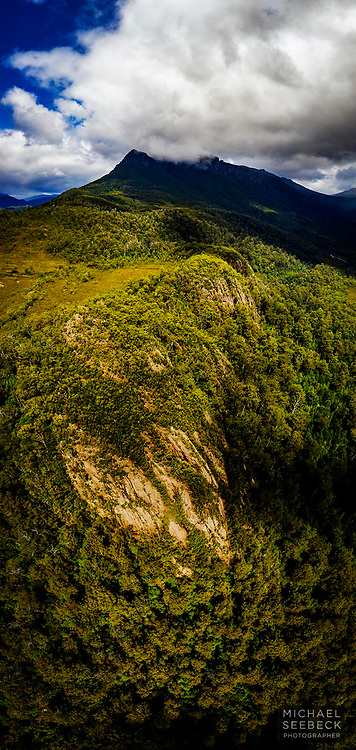 An aerial image of a mysterious rugged cloud-enshrouded peak in western Tasmania.<br /> <br /> Code: XADW0001<br /> <br /> Limited Edition of 15 prints only<br /> <br /> Add to cart to view options
