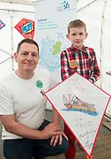 02/07/2017 REPRO FREE:  Glenn Heasley and Nathanial Foy from Galway with a Kite he made in the SFI tent  at Seafest 2017, the National Maritime Festival which  in Galway.<br /> . Photo:Andrew Downes, xposure .