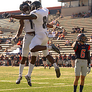 11/5/163:04:43 PM --- Football --- Fullerton College wide receiver Daurice Simpson (89) celebrates with Jerome Gross (14) as a dejected Orange Coast College's defensive back Garrett Grutz (6) looks on at LeBard Stadium in Costa Mesa, CA.