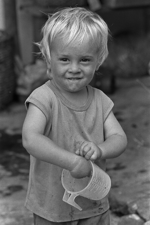 Black and white location portrait of Joel