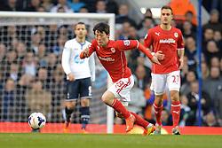 Cardiff's Kim Bo-Kyung runs with the ball - Photo mandatory by-line: Mitchell Gunn/JMP - Tel: Mobile: 07966 386802 02/03/2014 - SPORT - FOOTBALL - White Hart Lane - London - Tottenham Hotspur v Cardiff City - Premier League