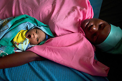 Twenty-three-year-old Lillian Seneme holds her newborn baby, Innocent, in swaddling blankets at the Juba Teaching Hospital in South Sudan. Hospitals throughout Sudan often struggle to find enough resources for their maternity wards.