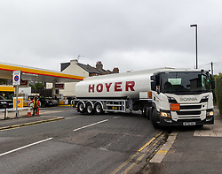 Licensed to London News Pictures. 25/09/2021. London, UK. A Hoyer truck leaves a Shell garage in Wimbledon, south-west London as desperate motorists stop to fill up, waiting in long queues with tailbacks over 3/4 mile on the second day of the fuel crisis. Yesterday, petrol stations across London and the South East were on critical levels with many running out of fuel as oil giants struggle to maintain deliveries due to the lack of HGV drivers. Photo credit: Alex Lentati/LNP