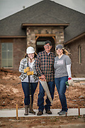 The Horton family in front of their soon to be completed home. Their old home was destroyed by the 2013 Moore tornadoes.