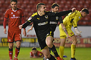 AFC Wimbledon defender Steve Seddon (15) scores the first goal and celebrates during the EFL Sky Bet League 1 match between Walsall and AFC Wimbledon at the Banks's Stadium, Walsall, England on 12 February 2019.