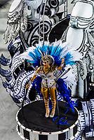 Performers on floats in the Carnaval parade of Unidos da Tijuca samba school in the Sambadrome, Rio de Janeiro, Brazil.
