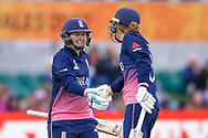 England womens cricket player Heather Knight (capt) celebrates her 50 and half century with partner England womens cricket player Natalie Sciver   during the ICC Women's World Cup match between England and Pakistan at the Fischer County Ground, Grace Road, Leicester, United Kingdom on 27 June 2017. Photo by Simon Davies.