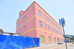 June 26, 2017 - Zhengzhou, Zhengzhou, China - Zhengzhou, CHINA-June 26 2017: (EDITORIAL USE ONLY. CHINA OUT) A 'paper-thin' building is under construction in Zhengzhou, central China's Henan Province, June 26th, 2017. The narrowest part of the building is only about 20 centimeters wide. (Credit Image: © SIPA Asia via ZUMA Wire)