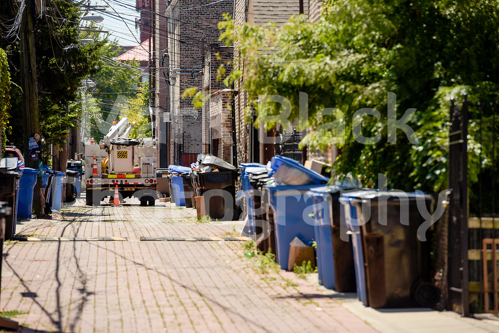 Pilsen neighborhood alley with garbage trash cans in Chicago on Wednesday, Aug. 19, 2020.  Photo by Mark Black