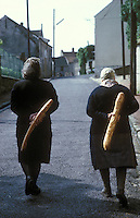 old friends with baguettes- Photograph by Owen Franken