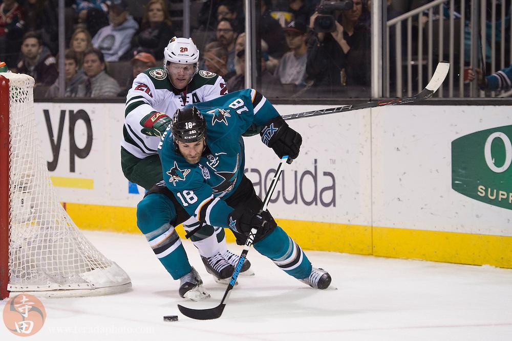 December 12, 2015; San Jose, CA, USA; San Jose Sharks right wing Mike Brown (18) controls the puck against Minnesota Wild defenseman Ryan Suter (20) during the second period at SAP Center at San Jose.