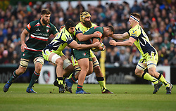 Leicester Tigers' Ellis Genge is tackled by Sale Sharks' Bryn Evans and Josh Strauss-during the Aviva Premiership match at Welford Road, Leicester.