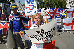 © Licensed to London News Pictures. 15/05/2019. London, UK. Remain campaigner STEVE BRAY (left) is seen remonstrating with a Brexit supporter in Westminster, London. Government has announced that MPs will get another chance to vote on Theresa May's Brexit Bill in early June, after EU parliament elections. Photo credit: Ben Cawthra/LNP