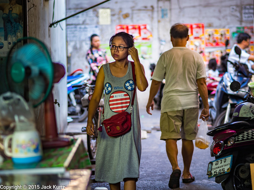 31 DECEMBER 2015 - BANGKOK, THAILAND: People walk in and out of Bang Chak Market. The market is supposed to close permanently on Dec 31, 2015. The Bang Chak Market serves the community around Sois 91-97 on Sukhumvit Road in the Bangkok suburbs. About half of the market has been torn down. Bangkok city authorities put up notices in late November that the market would be closed by January 1, 2016 and redevelopment would start shortly after that. Market vendors said condominiums are being built on the land.          PHOTO BY JACK KURTZ