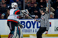 KELOWNA, BC - FEBRUARY 28: Linesman Josh Albinati delivers a new goalie stick to Roman Basran #30 of the Kelowna Rockets during second period against the Everett Silvertips at Prospera Place on February 28, 2020 in Kelowna, Canada. (Photo by Marissa Baecker/Shoot the Breeze)