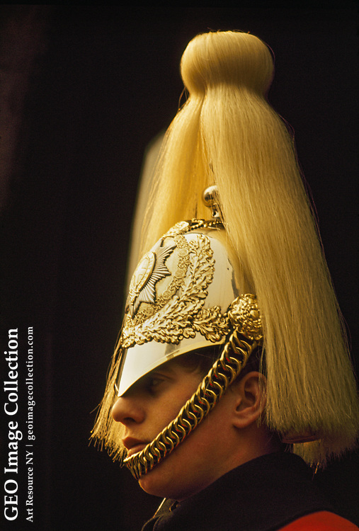 Profile of Queen's Life Guard with gold chin strap and plumed helmet.