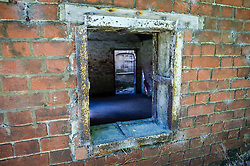 A rear window at the Nag's Head Cottage in Imber village on Salisbury Plain, Wiltshire, where residents were evicted in 1943 to provide an exercise area for US troops preparing to invade Europe. Roads through the MoD controlled village are now open and will close again on Monday August 22.