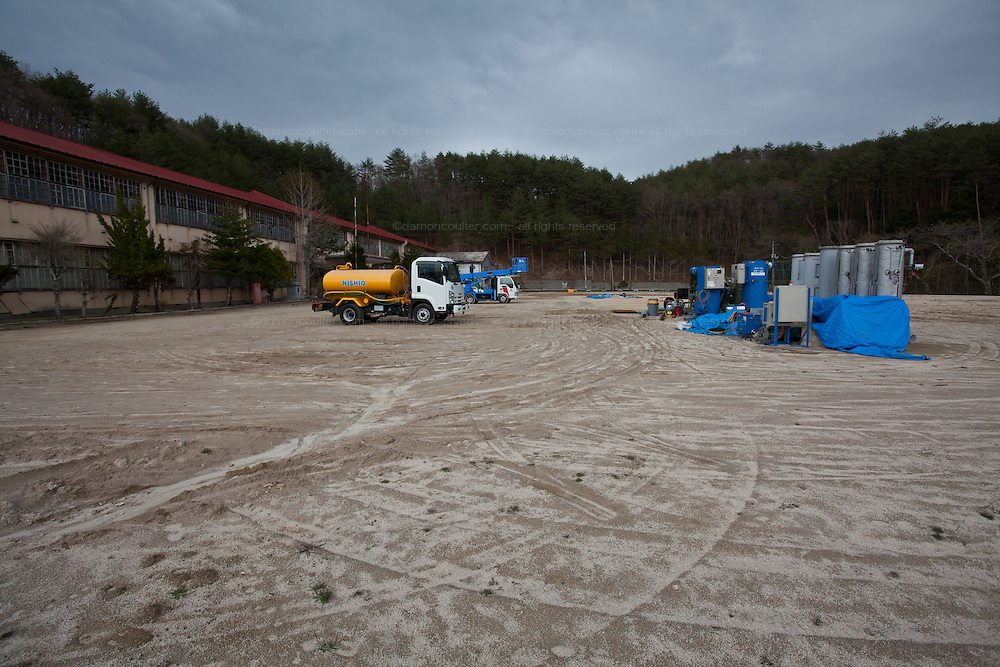 The grounds of a school that has had the top layer of soil removed to decontaminate it Kawauchi, Fukushima, Japan. Tuesday April 30th 2013
