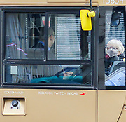6th March, 2021. Cheltenham, England. A woman wearing a mask waits to board a bus in the Promande area of Cheltenham.