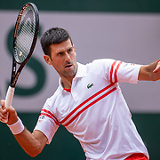 PARIS, FRANCE June 7.  Novak Djokovic of Serbia in action against Lorenzo Musetti of Italy on Court Philippe-Chatrier during the fourth round of the singles competition at the 2021 French Open Tennis Tournament at Roland Garros on June 7th 2021 in Paris, France. (Photo by Tim Clayton/Corbis via Getty Images)